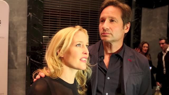 News video: Gillian Anderson Poses Topless With An Eel